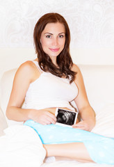 Pregnant woman with sonogram photo