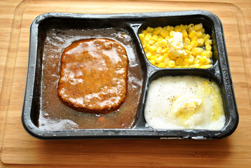 Tasty TV Dinner with Pepper and Butter Added