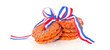 stacked Dutch Queensday cookies with a ribbon isolated on white
