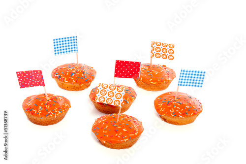 Queensday cake with flags and speckles isolated on white backgro