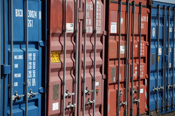 Blue and red cargo containers locked