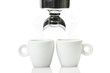An espresso machine group head  and two cup