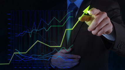 businessman hand drawing virtual chart business on touch screen