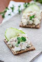 Smoked mackerel pate with herbs on crisp bread