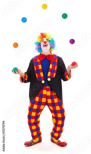 Juggler clown throwing colorful balls