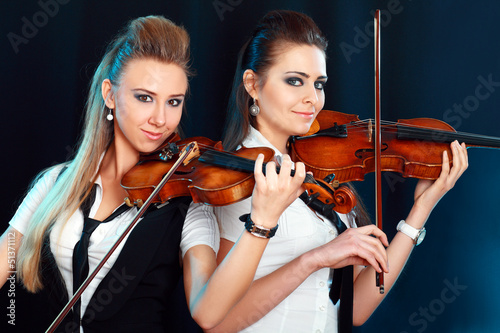 two woman with violin