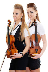 two woman play violin