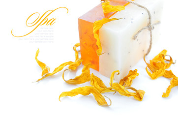 Handmade Soap with the yellow petals of flowers on a white
