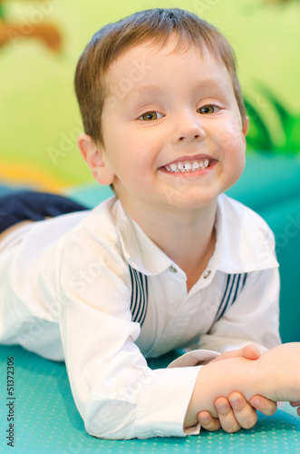 Smiling little boy in kindergarten