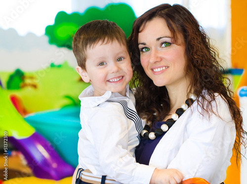 Portrait of woman and little boy in playroom