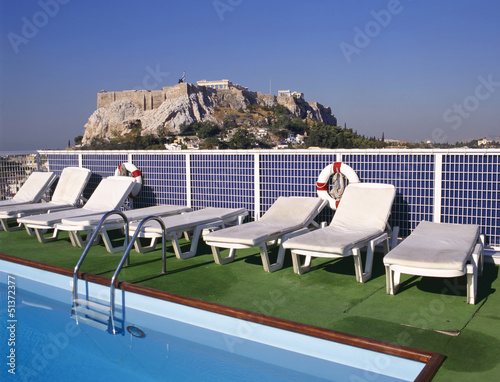 Swimmingpool and at background the Acropolis