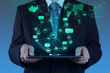 businessman using tablet computer shows internet and social netw