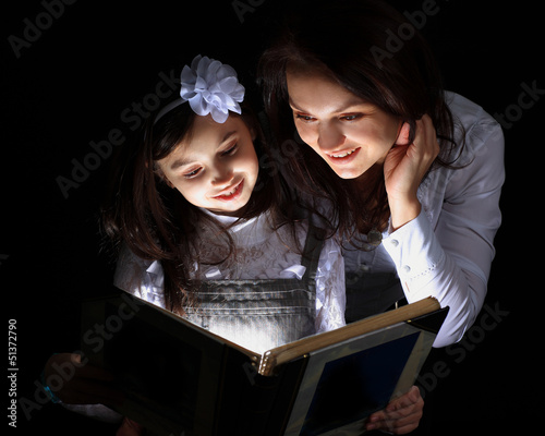 Girl with my mother found a wonderful book.
