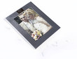 Broken photo frame of married couple