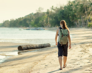 Young woman hiking with backpack