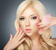 Beautiful blonde girl face with pink makeup and manicure