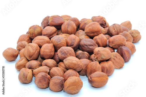 Isolated handful of brown clean cores of hazelnut