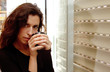 Photo of a beautiful young female drinking coffee and looking ou