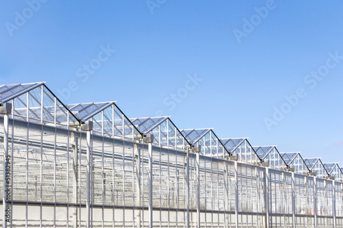 Green house with blue sky
