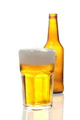 bottle and glass with beer on white background