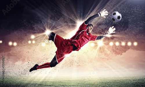 Goalkeeper catches the ball