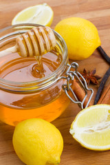 citrus honey in jar  and spices