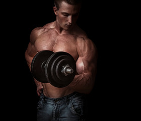 Man with a bar weights in hands training. Bodybuilding