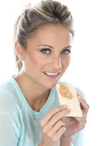 Woman Eating Crispbread with Peanut Butter