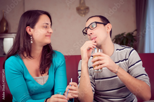 Romantic Young Couple Toasting and Drinking
