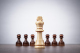 chess leadership concept over grey background