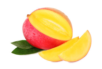 One ripe mango and two slices with drops (isolated)