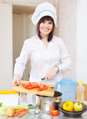 Cook  cooking with tomatoes