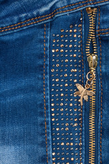 Pocket light blue jeans with zipper