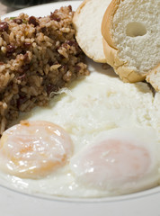 Nicaraguan style fried eggs breakfast with rice and bean gallo p