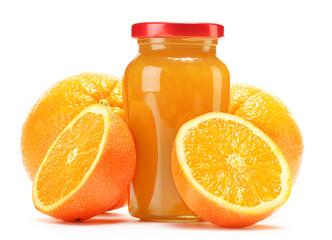Glass and jug of orange juice, jar of jam and fruits