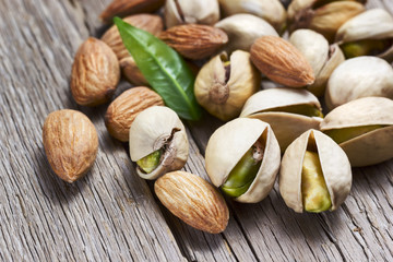 Almonds and pistachios with leaf