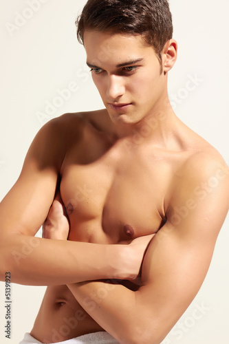 Strong handsome fitness sports man looking concentrated isolated