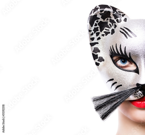 Beautiful young woman in cat mask