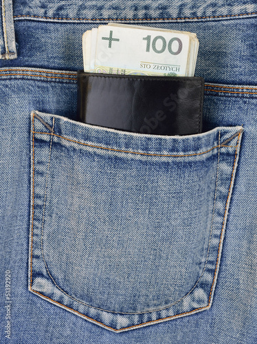 Back pocket of jeans with wallet and money