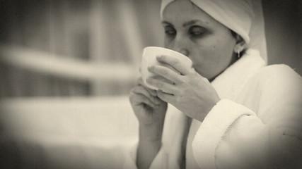 Old Film effect :Pretty girl drinks morning coffee