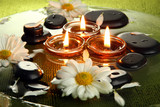 spa stones with flowers and candles in water on plate - 51397369