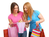 Two girl friends with shopping isolated on white