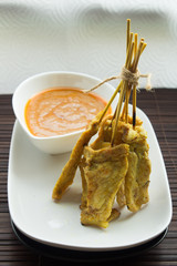 Pork satay with curry