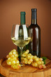 Composition of wine bottles, glass of white wine, grape