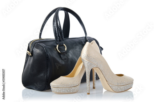 Pair of shoes and bag on white