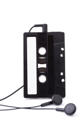 music cassette tape and headphones