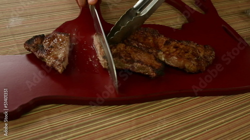 Slicing Grilled Strip Steaks