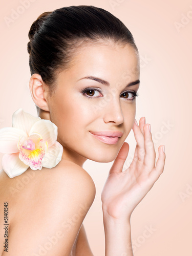 Beautiful smiling woman with healthy skin