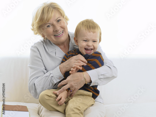 Grandmother getting a kiss from grandson
