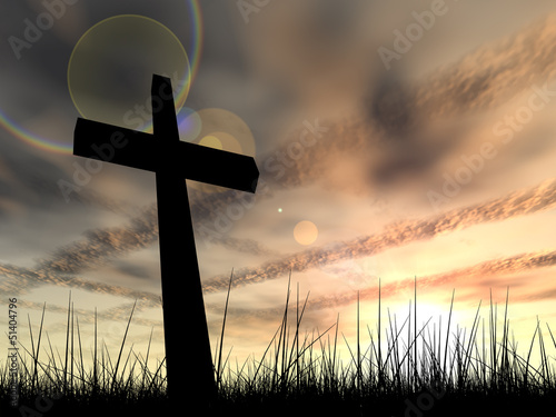 Conceptual religion cross over sunset